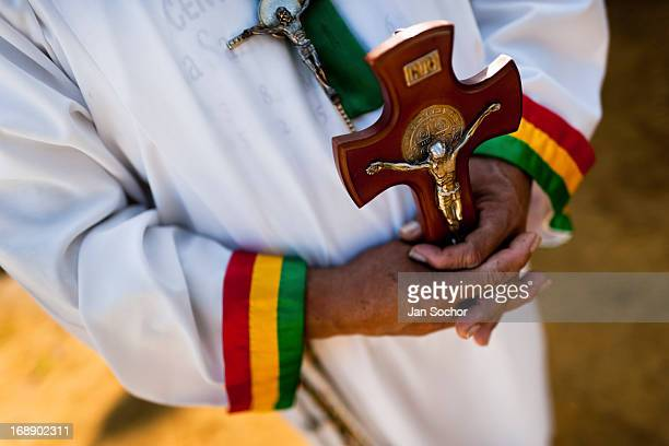 Hermes Cifuentes a Colombian spiritual healer helds a crucifix in his hands during a ritual of exorcism on 28 May 2012 in La Cumbre Colombia Exorcism...