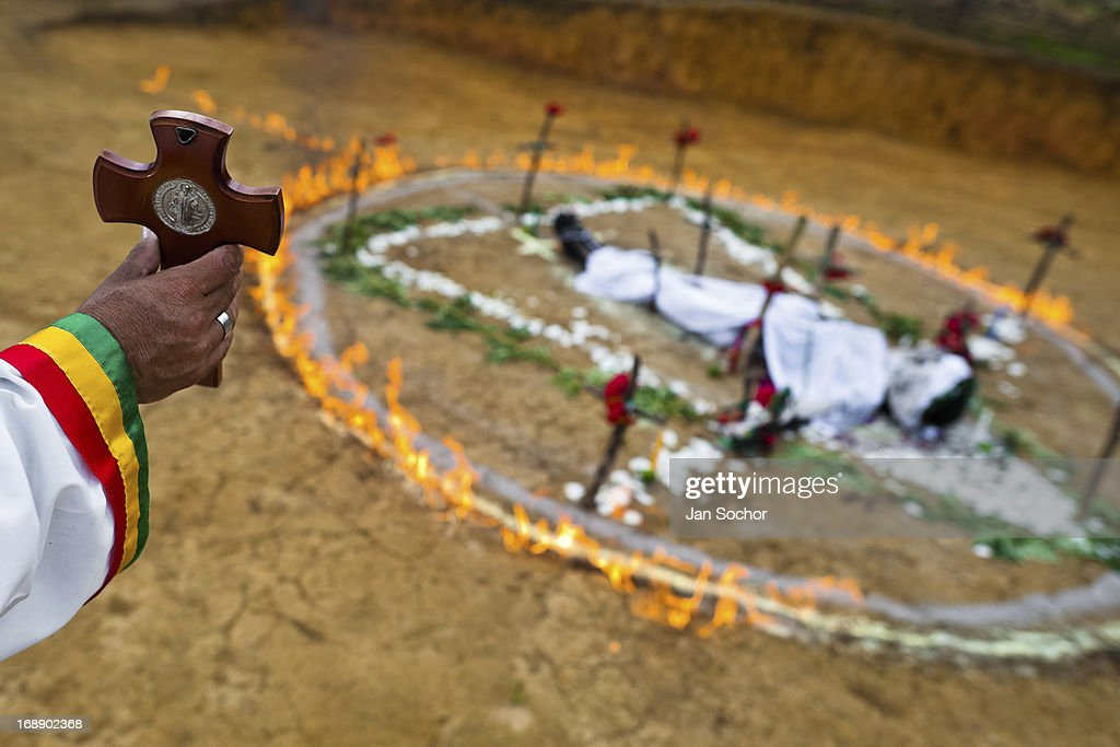 Hermes Cifuentes, a Colombian spiritual healer, helds a crucifix in his hand during a ritual of exorcism on 28 May 2012 in La Cumbre, Colombia. Exorcism is an ancient religious practice of evicting spirits, generally called demons or evil. Although the formal catholic rite of exorcism is rarely seen and must be only conducted by a designated priest, there are many pastors and preachers in Latin America performing exorcism ceremonies. The 52-year-old Brother Hermes, as the exorcist calls himself, claims to have been carrying out the healing rituals for more than 20 years. Using fire, dirt, candles, flowers, eggs and other natural-based items, in conjunction with Christian religous formulas, he attempts to drive the supposed evil spirit out of a victim's mind and body.