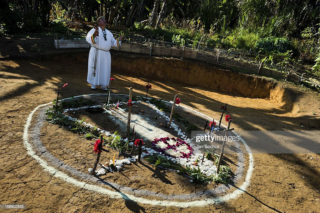 Hermes Cifuentes, a Colombian spiritual healer, prays before a ritual of exorcism on 28 May 2012 in La Cumbre, Colombia. Exorcism is an ancient religious practice of evicting spirits, generally called demons or evil. Although the formal catholic rite of exorcism is rarely seen and must be only conducted by a designated priest, there are many pastors and preachers in Latin America performing exorcism ceremonies. The 52-year-old Brother Hermes, as the exorcist calls himself, claims to have been carrying out the healing rituals for more than 20 years. Using fire, dirt, candles, flowers, eggs and other natural-based items, in conjunction with Christian religous formulas, he attempts to drive the supposed evil spirit out of a victim's mind and body.