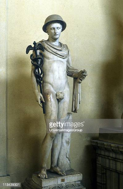 Hermes Greek god messenger of the gods god of roads and travellers holding his caduceus or herald's staff Marble statue