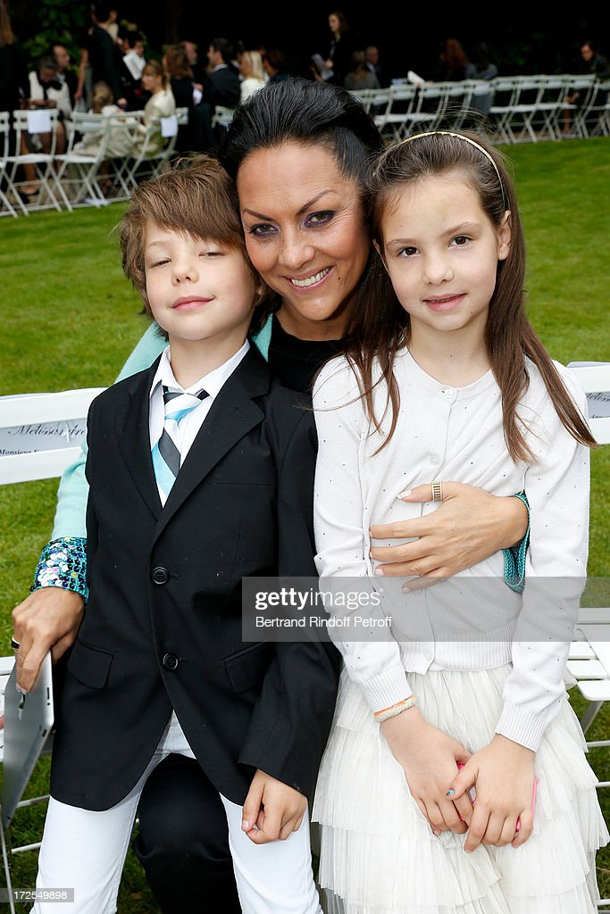 Hermine de Clermont-Tonnerre (C) and her children Allegra (R) and Calixte (L) attend the Frank Sorbier show as part of Paris Fashion Week Haute-Couture Fall/Winter 2013-2014 at Hotel De Bezenval on July 3, 2013 in Paris, France.