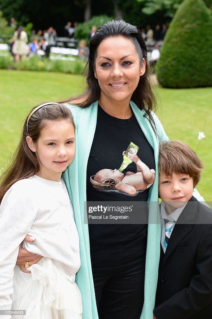 Hermine de Clermont-Tonnerre (C) and her childs Allegra (L) and Calixte (R) attend the Frank Sorbier show as part of Paris Fashion Week Haute-Couture Fall/Winter 2013-2014 at Hotel De Bezenval on July 3, 2013 in Paris, France.