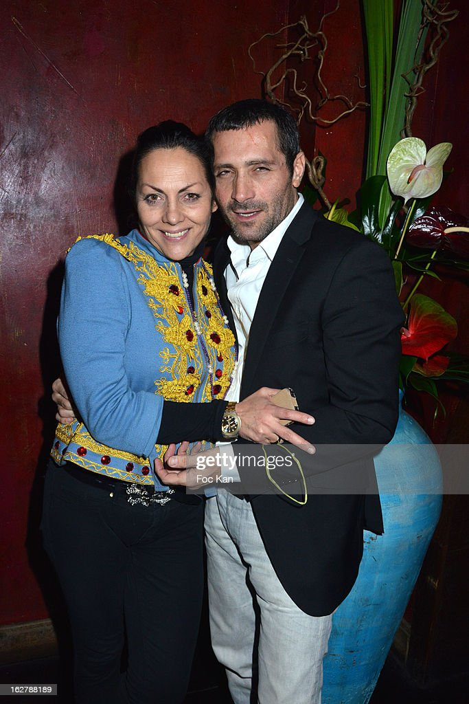 Hermine de Clermont-Tonnerre (L) poses with David Setruk from Buddha Bar duri9ng the 'Tour 66' Tony Frank's Photo Exhibition Preview at Buddha Bar on February 26, 2013 in Paris, France.