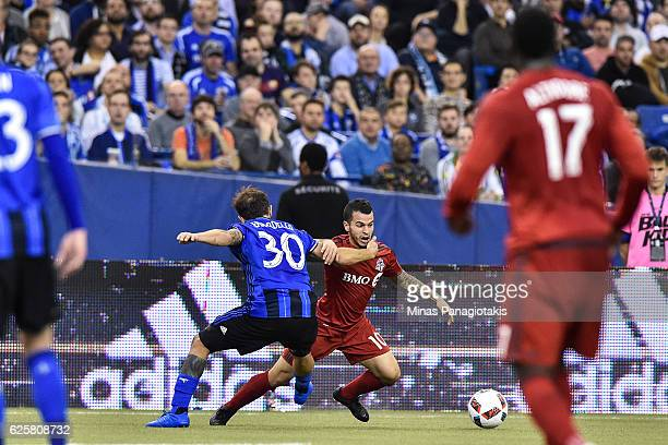 Hernan Bernardello of the Montreal Impact challenges Sebastian Giovinco of the Toronto FC during leg one of the MLS Eastern Conference finals at...