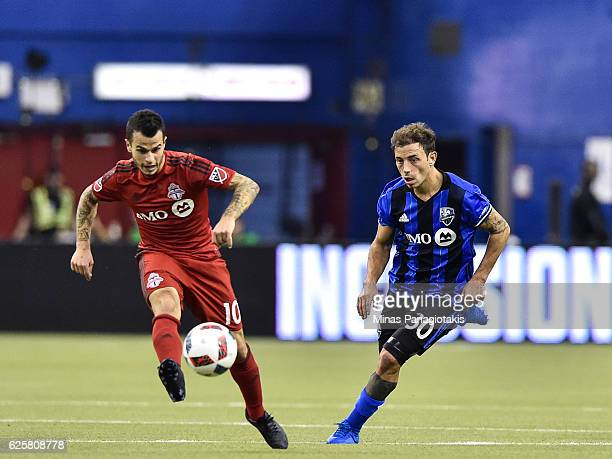 Hernan Bernardello of the Montreal Impact chases the ball after Sebastian Giovinco of the Toronto FC kicks it during leg one of the MLS Eastern...