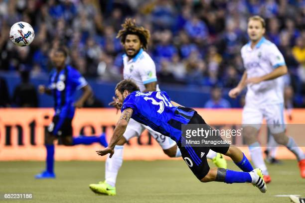 Hernan Bernardello of the Montreal Impact jumps to play the ball with his head during the MLS game against the Seattle Sounders FC at Olympic Stadium...