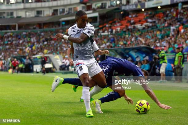 Hernan Burbano of Leon and Pablo Miguez of Puebla fight for the ball during the 15th round match between Leon and Puebla as part of the Torneo...