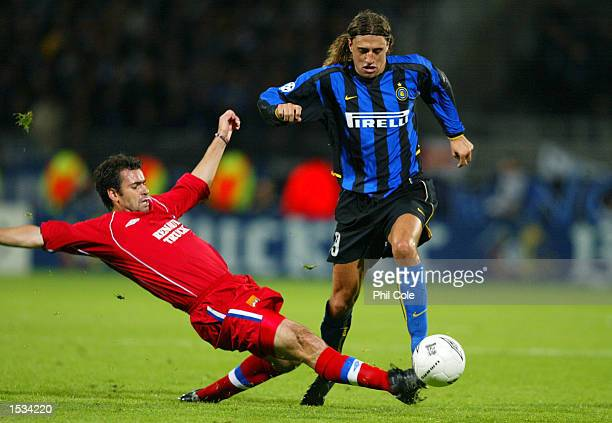 Hernan Crespo of Inter Milan is challenged by Florent Laville of Lyon during the UEFA Champions League First Phase Group D match between Lyon and...