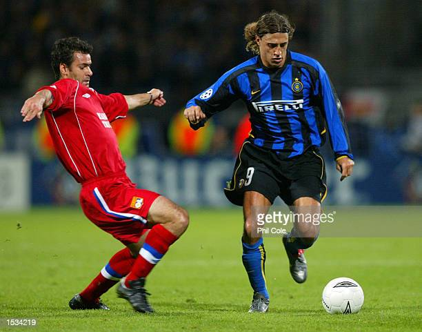 Hernan Crespo of Inter Milan takes on Florent Laville of Lyon during the UEFA Champions League First Phase Group D match between Lyon and Inter Milan...