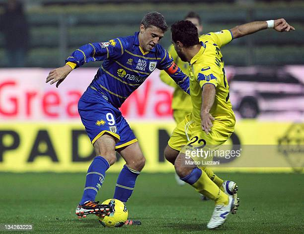 Hernan Crespo of Parma FC battles for the ball with Domenico Maietta of Hellas Verona during the Tim Cup match between Parma FC and Hellas Verona at...