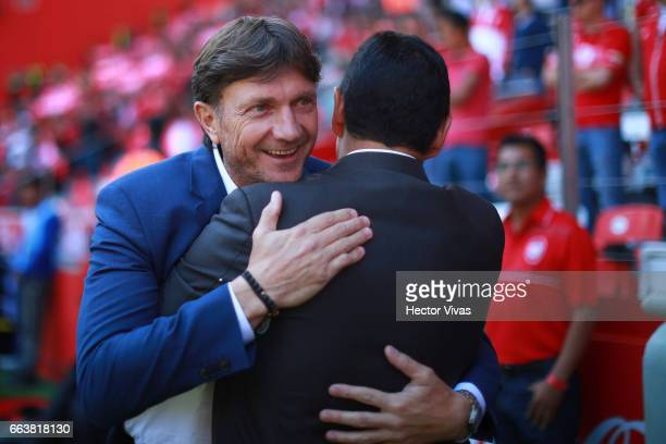 Hernan Cristante head Coach of Toluca hugs Luis alfonso Sosa coach of Necaxa during the 12th round match between Toluca and Necaxa as part of the...