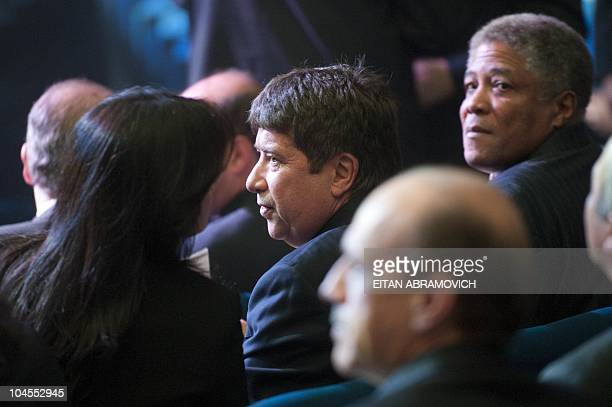 Hernan Dario Gomez and Francisco Maturana coach and manager of Colombian national football team respectively attend the launching ceremony for the...