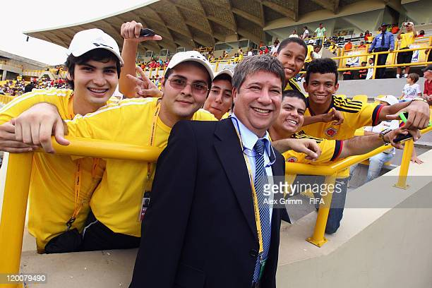 Hernan Dario Gomez head coach of the Colombian national football team poses with fans before the FIFA U20 World Cup 2011 group E match between...