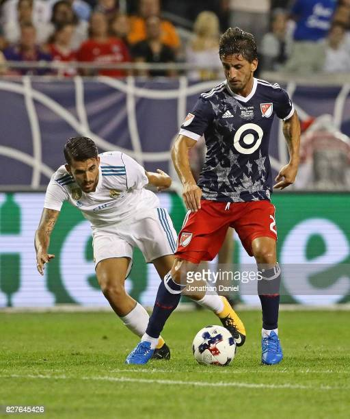 Hernan Grana of the MLS ALLStars moves past Dani Ceballos of Real Madrid during the 2017 MLS All Star Game at Soldier Field on August 2 2017 in...