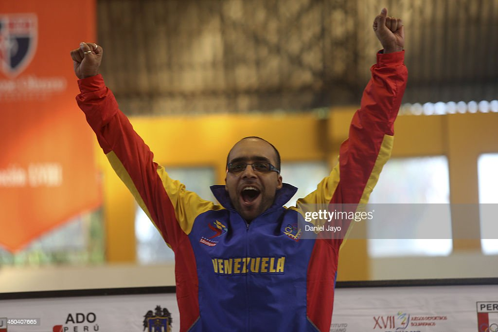 Hernan Jansen, of Venezuela, celebrates on the podium after winning the gold medal in fencing event as part of the XVII Bolivarian Games Trujillo 2013 at Colegio San JosŽ Obrero Coliseum on November 18, 2013 in Trujillo, Peru.