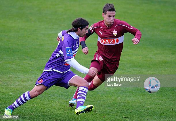 Hernan Losada challenges Stefano Celozzi of Stuttgart during a friendly match between VfB Stuttgart and Germinal Beerschot Antwerpen at Kempinski...