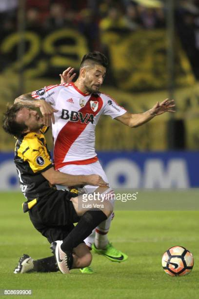 Hernan Novick of Guarani fights for the ball with Milton Casco of River Plate during a first leg match between Guarani and River Plate as part of...