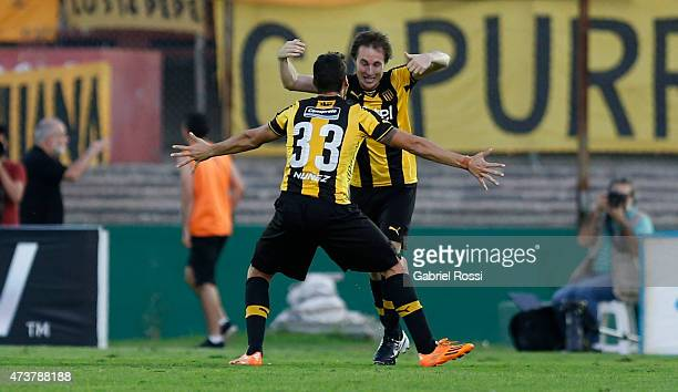 Hernan Novick of Peñarol celebrates with his teammates after scoring the first goal of his team during a match between Peñarol and Nacional as part...
