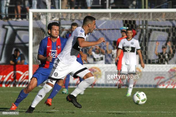 Hernan Pellerano of Olimpia fights for the ball with Nelson Haedo Valdez of Cerro Porteño during a match between Olimpia and Cerro Porteño as part of...