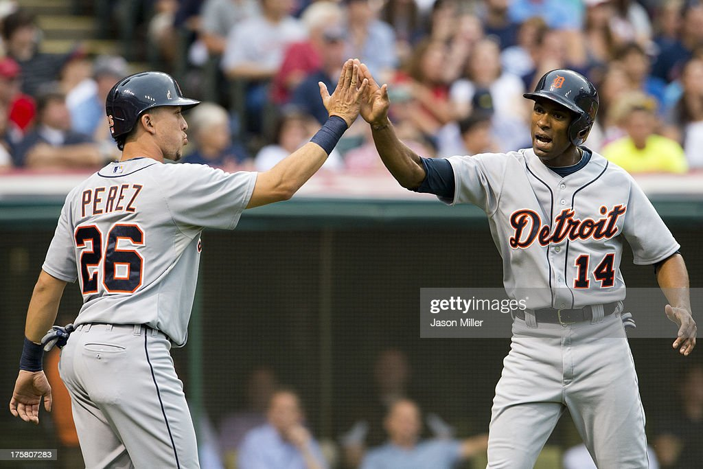 Hernan Perez #26 celebrates with <a gi-track='captionPersonalityLinkClicked' href=/galleries/search?phrase=Austin+Jackson&family=editorial&specificpeople=608633 ng-click='$event.stopPropagation()'>Austin Jackson</a> #14 of the Detroit Tigers after both scored on a double by Prince Fielder #28 during the third inning against the Cleveland Indians at Progressive Field on August 8, 2013 in Cleveland, Ohio.