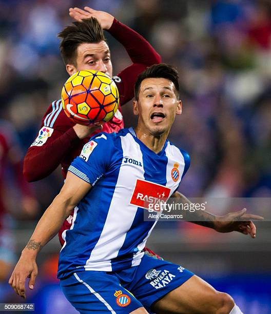 Hernan Perez of RCD Espanyol competes for the ball with Hector Hernandez of Real Sociedad de Futbol during the La Liga match between RCD Espanyol and...