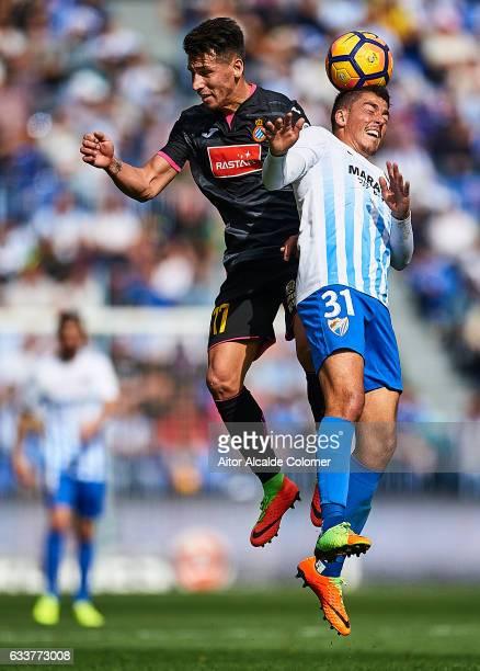Hernan Perez of RCD Espanyol competes for the ball with Pablo Fornals of Malaga CF during La Liga match between Malaga CF and RCD Espanyol at La...