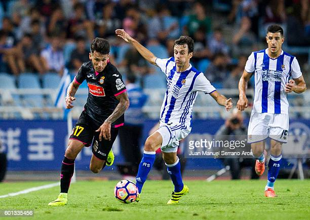 Hernan Perez of RCD Espanyol duels for the ball with Ruben Pardo of Real Sociedad during the La Liga match between Real Sociedad de Futbol and RCD...