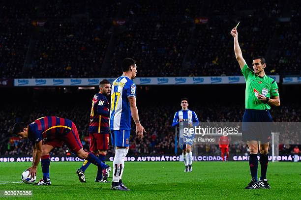 Hernan Perez of RCD Espanyol is shown a second yellow card for a challenge on Jordi Alba of FC Barcelona by the referee Juan Martinez Munuera during...