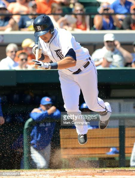 Hernan Perez of the Detroit Tigers jumps out of the way of a inside pitch during the spring training game against the Toronto Blue Jays at Joker...