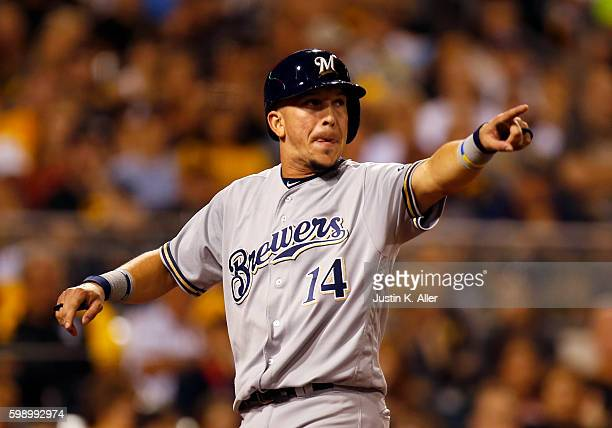 Hernan Perez of the Milwaukee Brewers celebrates after scoring on a RBI single in the eighth inning during the game against the Pittsburgh Pirates at...