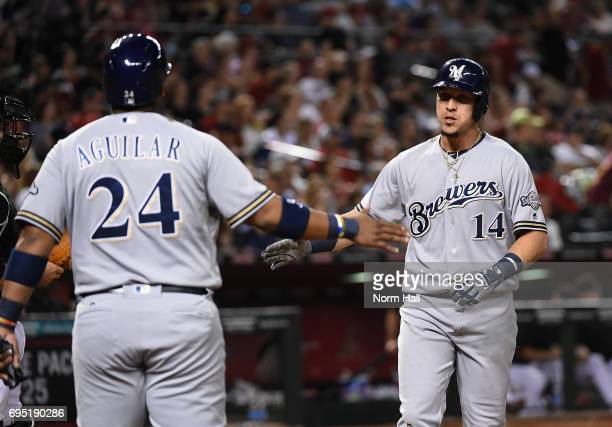 Hernan Perez of the Milwaukee Brewers celebrates with teammate Jesus Aguilar after hitting a two run home run during the fourth inning against the...