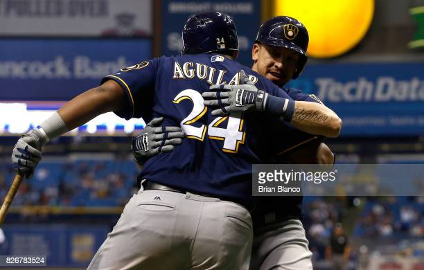 Hernan Perez of the Milwaukee Brewers celebrates with teammate Jesus Aguilar after hitting a home run during the ninth inning of a game against the...