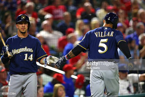 Hernan Perez of the Milwaukee Brewers congratulates Jonathan Villar for scoring in the fifth inning against the Texas Rangers at Globe Life Park in...