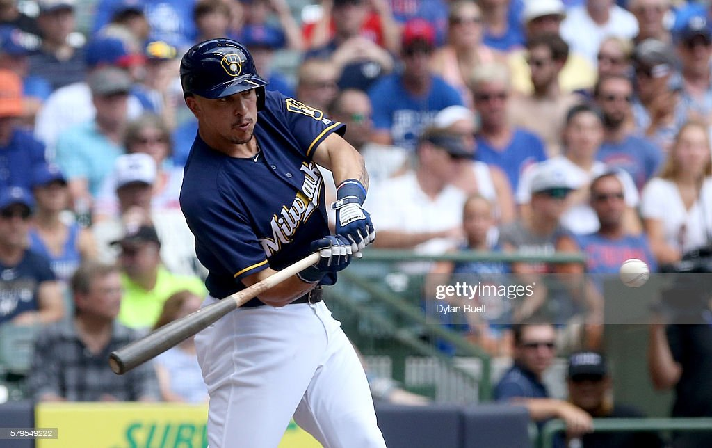 Hernan Perez of the Milwaukee Brewers hits a sacrifice fly in the first inning against the Chicago Cubs at Miller Park on July 24 2016 in Milwaukee...