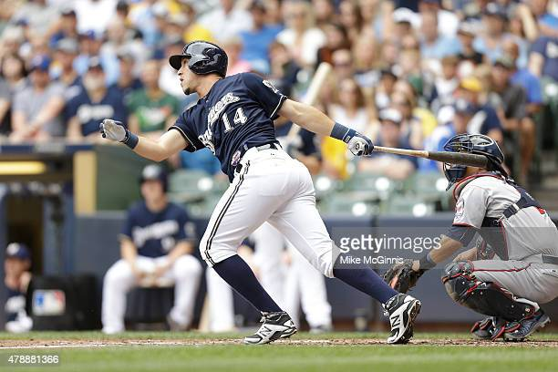 Hernan Perez of the Milwaukee Brewers hits a single in the second inning against the Minnesota Twins during the Interleague game at Miller Park on...