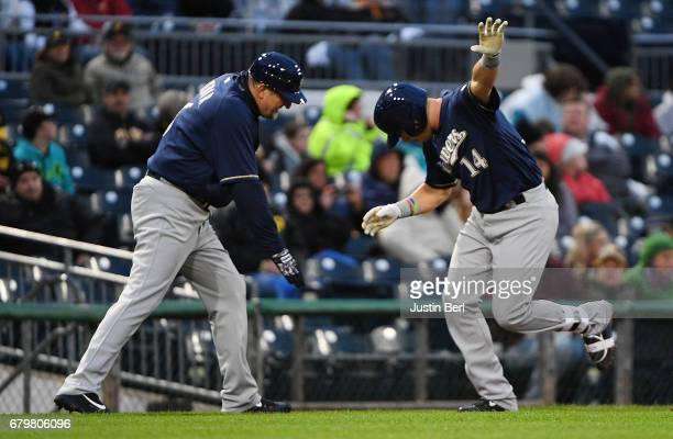 Hernan Perez of the Milwaukee Brewers is greeted by Ed Sedar after hitting a solo home run in the fourth inning during the game against the...