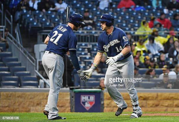 Hernan Perez of the Milwaukee Brewers is greeted by Travis Shaw after hitting a solo home run in the fourth inning during the game against the...