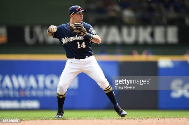 Hernan Perez of the Milwaukee Brewers makes a throw to first base during a game against the Chicago Cubs at Miller Park on April 9 2017 in Milwaukee...