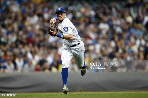 Hernan Perez of the Milwaukee Brewers makes a throw to first base during the fifth inning of a game against the Los Angeles Dodgers at Miller Park on...