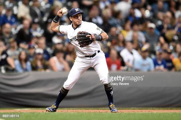 Hernan Perez of the Milwaukee Brewers makes a throw to second base during the seventh inning of a game against the San Francisco Giants at Miller...