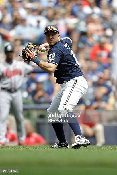 Hernan Perez of the Milwaukee Brewers makes the throw to first base for an out during the game against the Atlanta Braves at Miller Park on July 08...