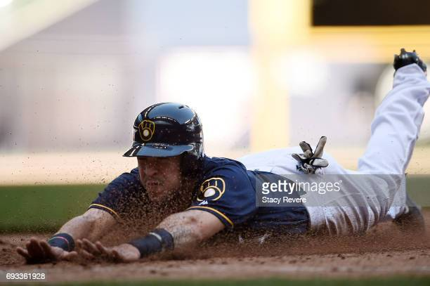 Hernan Perez of the Milwaukee Brewers slides into first base during a game against the Los Angeles Dodgers at Miller Park on June 4 2017 in Milwaukee...