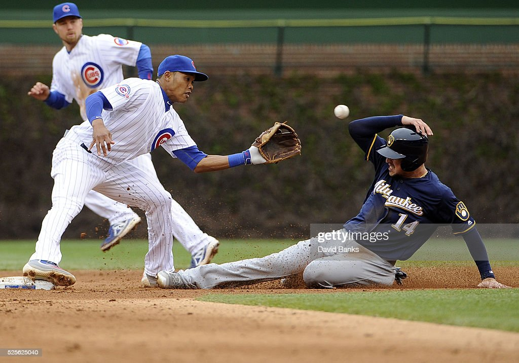Hernan Perez #14 of the Milwaukee Brewers steals second base as Addison Russell #27 of the Chicago Cubs takes the throw during the seventh inning on April 28, 2016 at Wrigley Field in Chicago, Illinois.