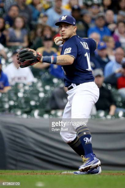 Hernan Perez of the Milwaukee Brewers throws to first base in the first inning against the Cincinnati Reds at Miller Park on April 24 2017 in...