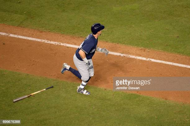Hernan Perez of the Milwaukee Brewers watches the home run ball in flight during the fifth inning of the game against the Arizona Diamondbacks at...