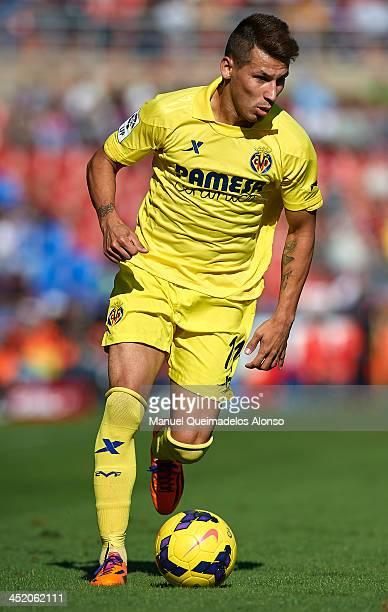 Hernan Perez of Villarreal runs with the ball during the La Liga match between Levante UD and Villarreal CF at Ciutat de Valencia on November 24 2013...