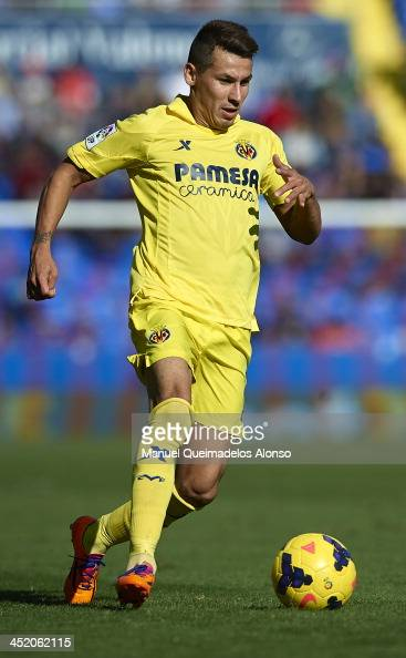 Hernan Perez of Villarreal runs with the ball during the La Liga match between Levante UD and Villarreal CF at Ciutat de Valencia on November 24 2013...