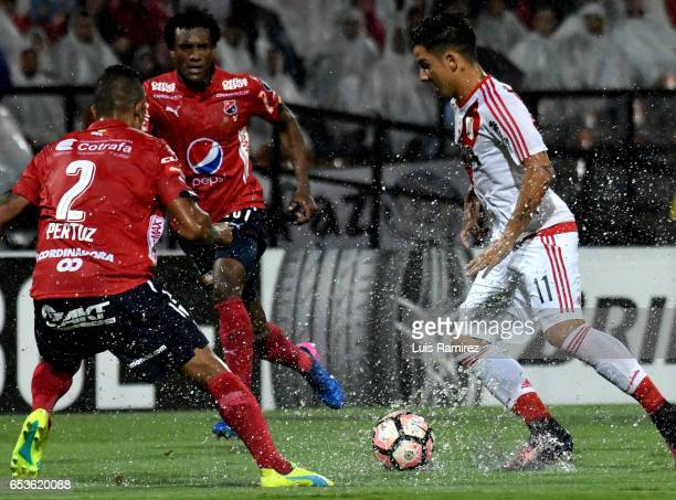 Hernan Pertuz of Deportivo Independiente Medellin vies for the ball with Sebastian Driussi of River Plate during a group stage match between Deporivo...