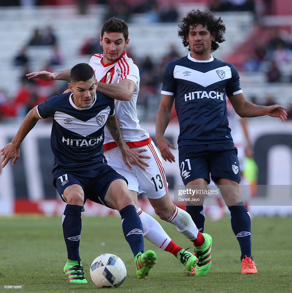 Hernan Toledo, of Velez Sarsfield, (L) and Lucas Alario, of River Plate, battle for the ball during a match between River Plate and Velez Sarsfield as part of Torneo Transicion 2016 at Antonio Vespucio Liberti Stadium on April 30, 2016 in Buenos Aires, Argentina.