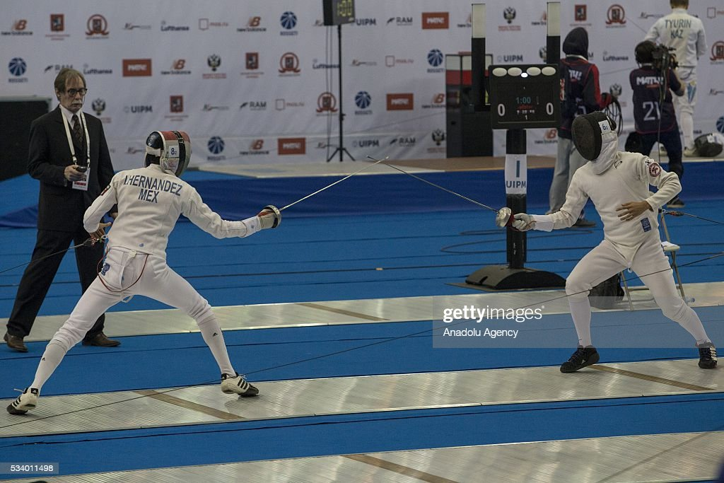 Hernandez Uscanga Ismael (Mexica)(Left) and Jun Woongtae (Korea) during the men's relay World Championship in modern pentathlon in Moscow in Olympic Sports Complex in Moscow, Russia, on May 24, 2016.